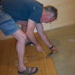 Tim is installing bamboo flooring.